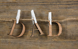 Close up of dad text hanging on string Royalty Free Stock Images