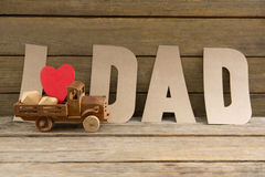 Close up of dad text by heart shape in toy truck Royalty Free Stock Photos
