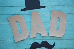 Close up of dad text with mustache and hat on table Royalty Free Stock Photography