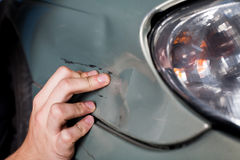 Close-up of damaged car  inspected by mechanic Stock Photo