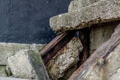 Damaged concrete steps. Rustic textures. Close up of damaged concrete steps. Damage is due to exposure to the ocean. Exposed rusty support structures royalty free stock photos