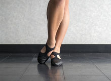 Close up of Dancer with Bevelled foot in Jazz dig position. Close up of a Jazz dancer`s feet in the studio in a bevelled dig position stock photo