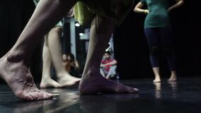 A close up of a dancer steps in slow motion