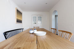 Close up of Danish styled dining room table and chairs Royalty Free Stock Photos
