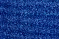 Close up of dark blue color carpet texture background with seamless pattern stock photos
