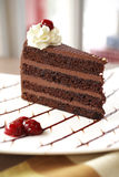Close up dark chocolate cake and cherry Royalty Free Stock Photography