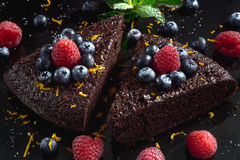 Close up of dark chocolate cake decorated with raspberries.  Stock Image