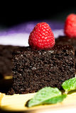 Close up of Dark chocolate cake with raspberries.  Stock Photos