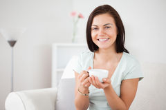 Close up of a dark-haired woman drinking tea Royalty Free Stock Photo