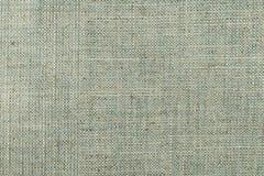 Close up of dark khaki colored fine textured cotton Stock Photos