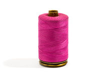 Close up Dark Pink Cotton Thread on a Reel Royalty Free Stock Images