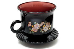 Close-up of dark red dish and cup set Royalty Free Stock Photo