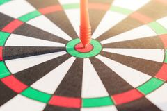 Close up dartboard. With arrow in center focused point represent business goal concept Stock Photography