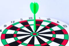 Close up dartboard. With arrow in center focused point  on white background represents business goal concept Stock Image