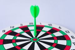 Close up dartboard. With arrow in center focused point  on white background represents business goal concept Royalty Free Stock Images