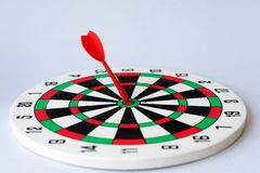 Close up dartboard. With arrow in center focused point isolated on white background represents business goal concept Stock Photography