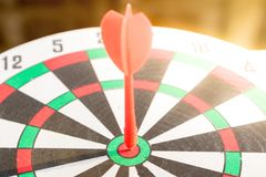 Close up dartboard. With arrow in center focused point represent business goal concept Royalty Free Stock Photos