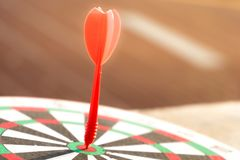 Close up dartboard. With arrow in center focused point represent business goal concept Stock Photos