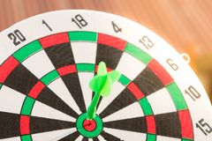 Close up dartboard. With arrow in center focused point represent business goal concept Royalty Free Stock Photo