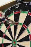Close Up Of Dartboard With Three Darts In Treble Twenty Stock Photos
