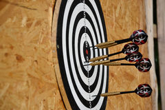 Close up of darts arrows being stuck in the target board Stock Image