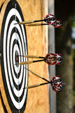 Close up of darts arrows being stuck in the target board Royalty Free Stock Image