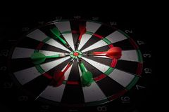 Darts arrows in the target center. Smart goal setting, dart hit royalty free stock images