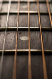Close up das cordas e Fretboard da guitarra Fotografia de Stock Royalty Free