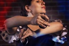 Close up das mãos de um jogador das castanholas do espanhol Foto de Stock