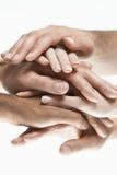 Close up das mãos empilhadas multi-étnicos Foto de Stock
