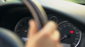 Close up of dashboard and male hand steering wheel, driver stuck in traffic jam. Stock footage stock footage