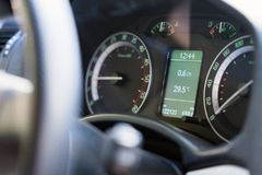 Close up dashboard of a modern car mileage and temperature.  Stock Photos