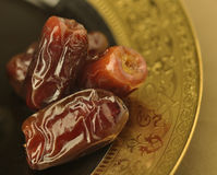 Close up of dates. An extreme close up of dates in golden plate Royalty Free Stock Image