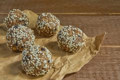 Close up of dates oatmeal balls. No cook energy bites, selective focus royalty free stock images