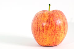 Close up de único Apple no branco Imagens de Stock