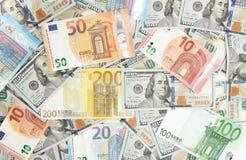 Close-up de dólares americanos e de euro americanos Fotos de Stock Royalty Free