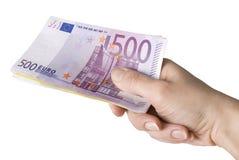 Close-up de euro- notas de banco na mão da mulher. Fotografia de Stock Royalty Free
