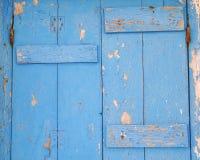 Close up de madeira pintado azul da superfície da porta Fotografia de Stock