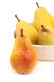 Close up de quatro peras no branco com espaço da cópia Fotografia de Stock Royalty Free