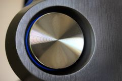 Close up de um botão redondo do volume foto de stock
