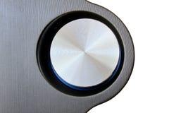 Close up de um botão redondo do volume isolado no fundo branco fotografia de stock royalty free