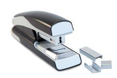 Close up de um grampeador cinzento e de grampos do escritório Fotos de Stock Royalty Free