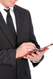 Close-up de um homem de negócio com prancheta e pena Fotos de Stock