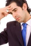 Close-up de um homem de negócio novo com uma dor de cabeça Imagem de Stock Royalty Free