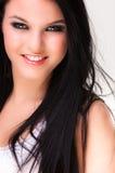 Close up de um sorriso alegre da mulher nova Fotografia de Stock Royalty Free