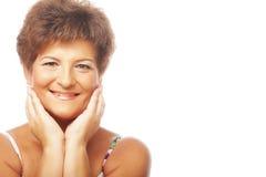 Close-up de um sorriso maduro da mulher Foto de Stock Royalty Free