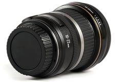 Close up de uma lente isolada no branco Foto de Stock