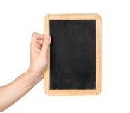 Close up de uma mão que guarda uma placa do menu Imagens de Stock