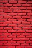 Close-up de uma parede de tijolo pintada vermelha Fotografia de Stock