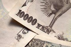 Close-up de uma parte traseira da nota de 10000 ienes japoneses Foto de Stock